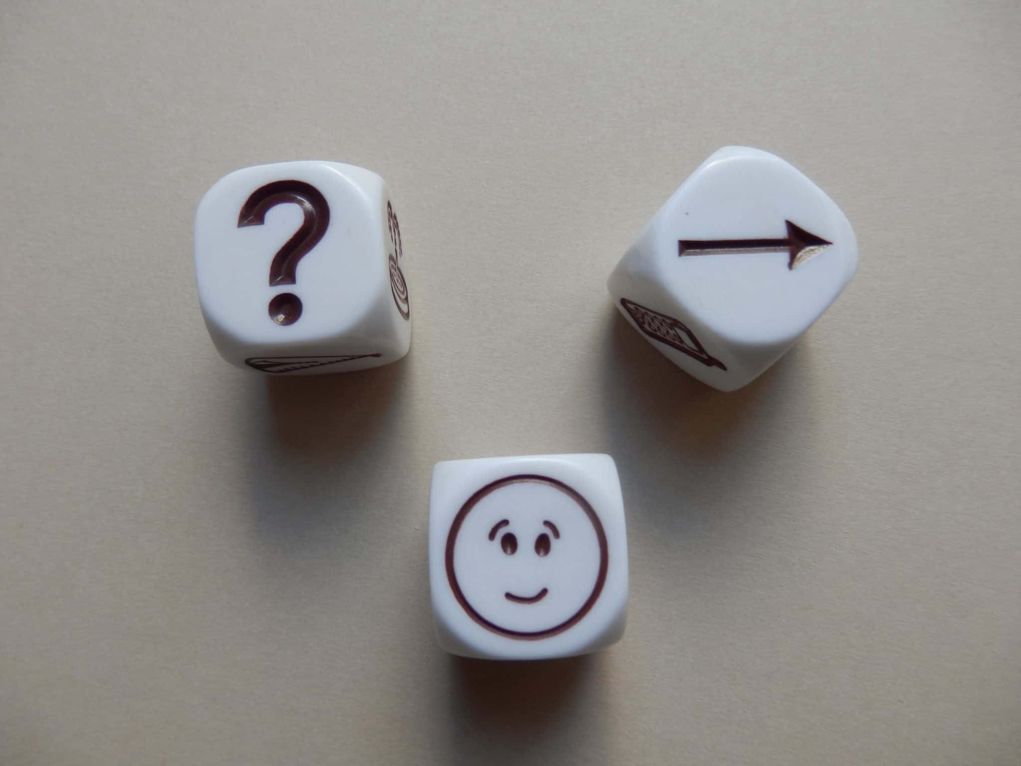 picture of dice showing a question, face and arrow towards the game of creating an online omnipresence.