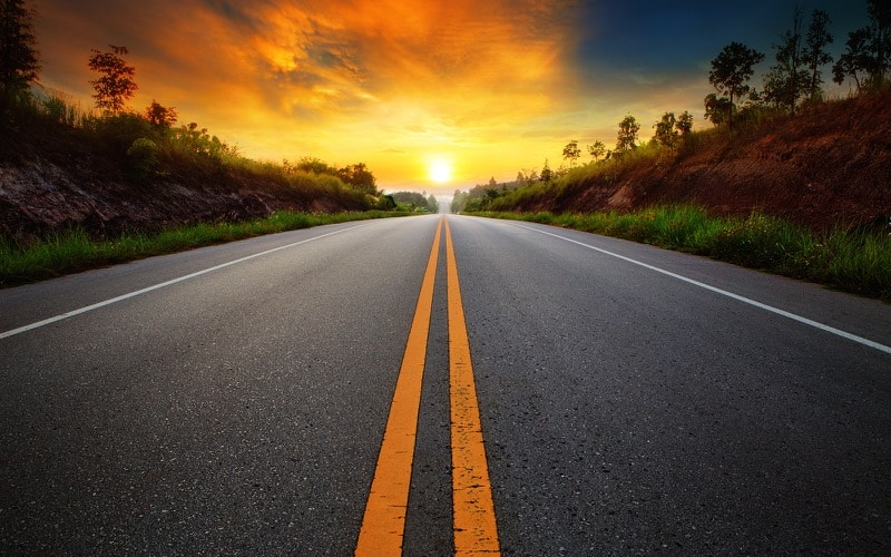 Road leading towards a beautiful sunrise for Online Marketing Services for Alternative Energy Companies post